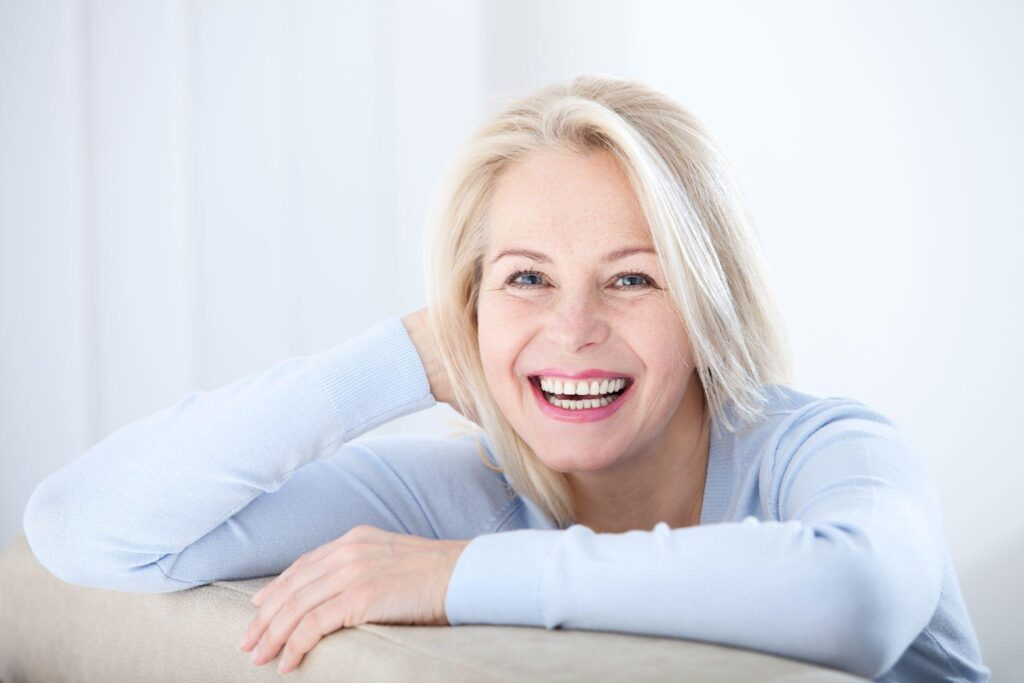 Active beautiful middle-aged woman smiling friendly and looking in camera