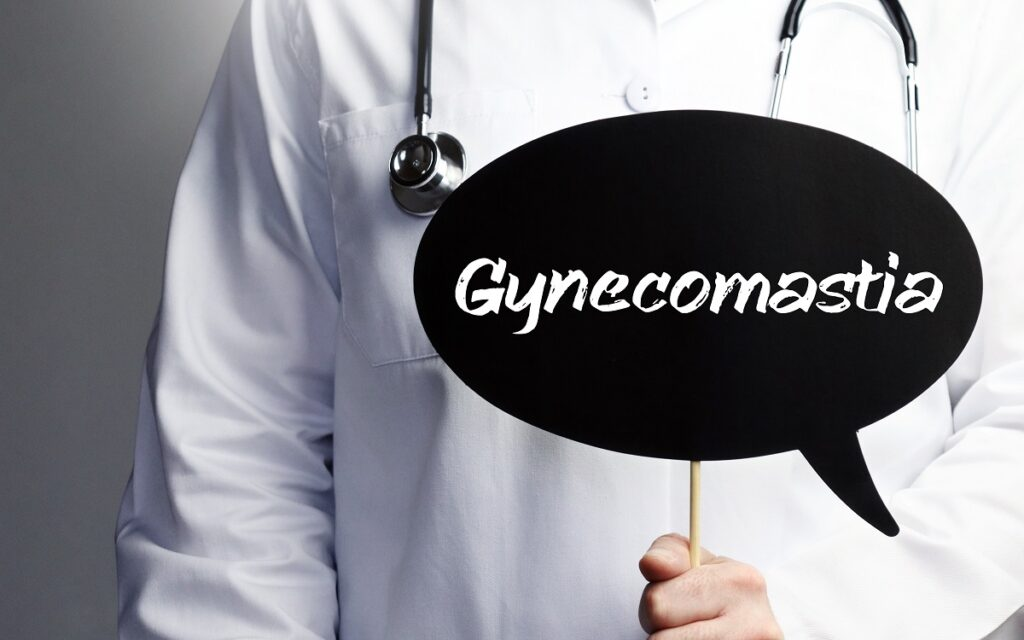 Gynecomastia. Doctor with stethoscope holds speech bubble in hand