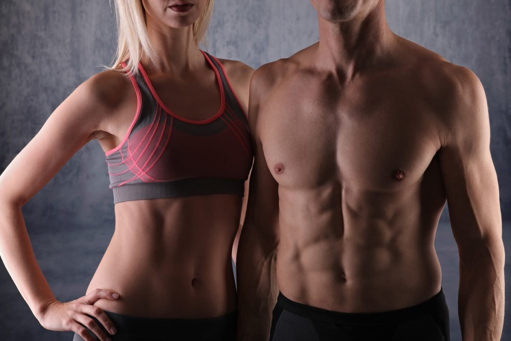 Fit couple, strong muscular man and slim woman