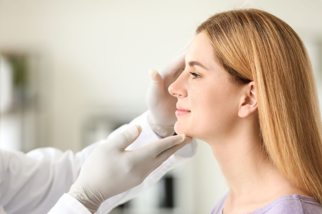 woman meeting with plastic surgeon